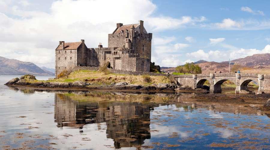 Panorama Reflection of Eilean Donan Castle, Highland Scotland.