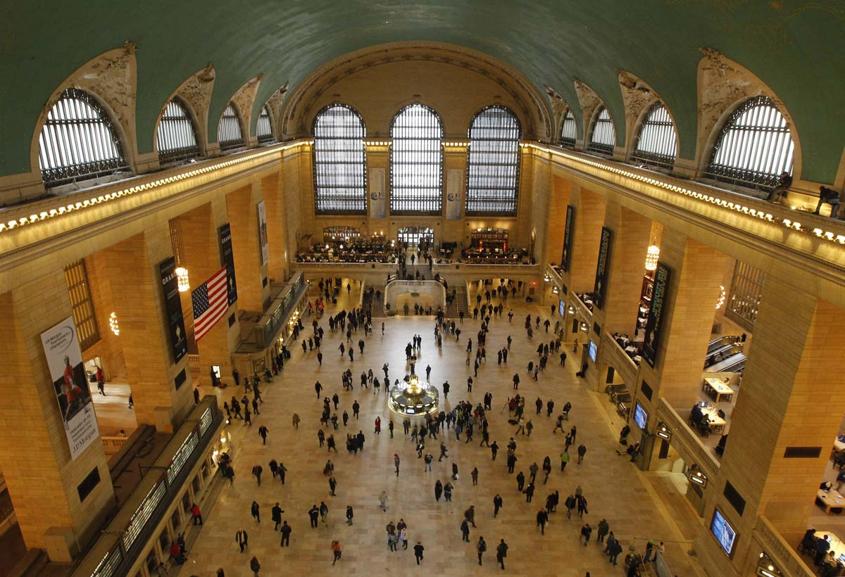 Commuters move through the grand hall of Grand Central Terminal in New York