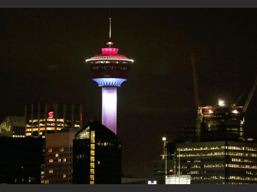 The Calgary Tower was lit up with the colors of the French flag to show support and sympathy regarding the Paris attacks in Calgary, Alberta on Friday, Nov. 13, 2015. (Larry MacDougal/The Canadian Press via AP)/LMD101/94800388549/MANDATORY CREDIT/1511140555