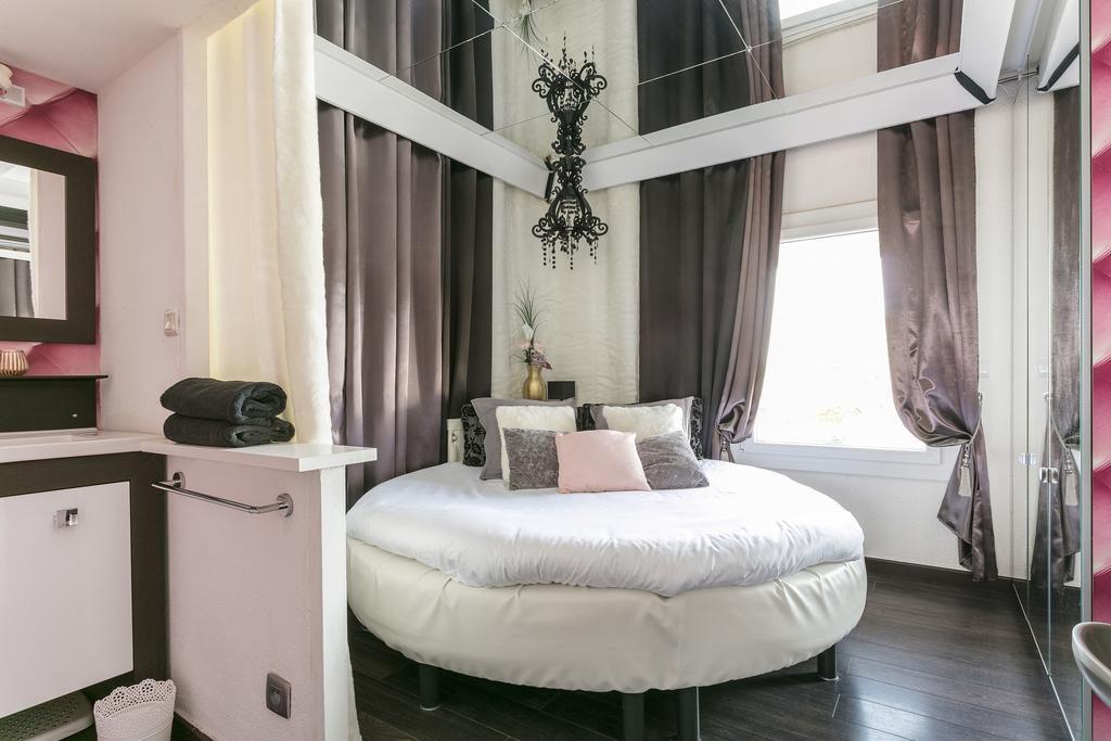 Chambre de l'appartement la vie en rose Port Nature